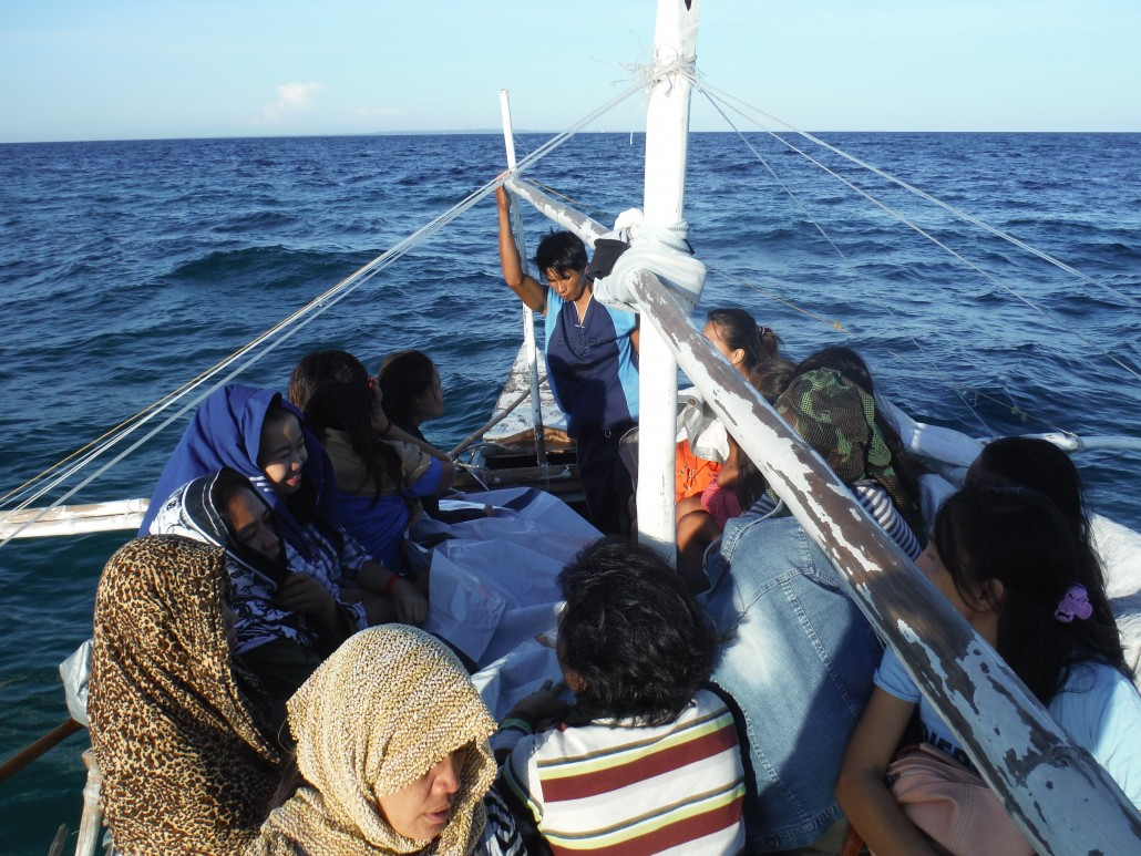 The teachers huddled together in the boat